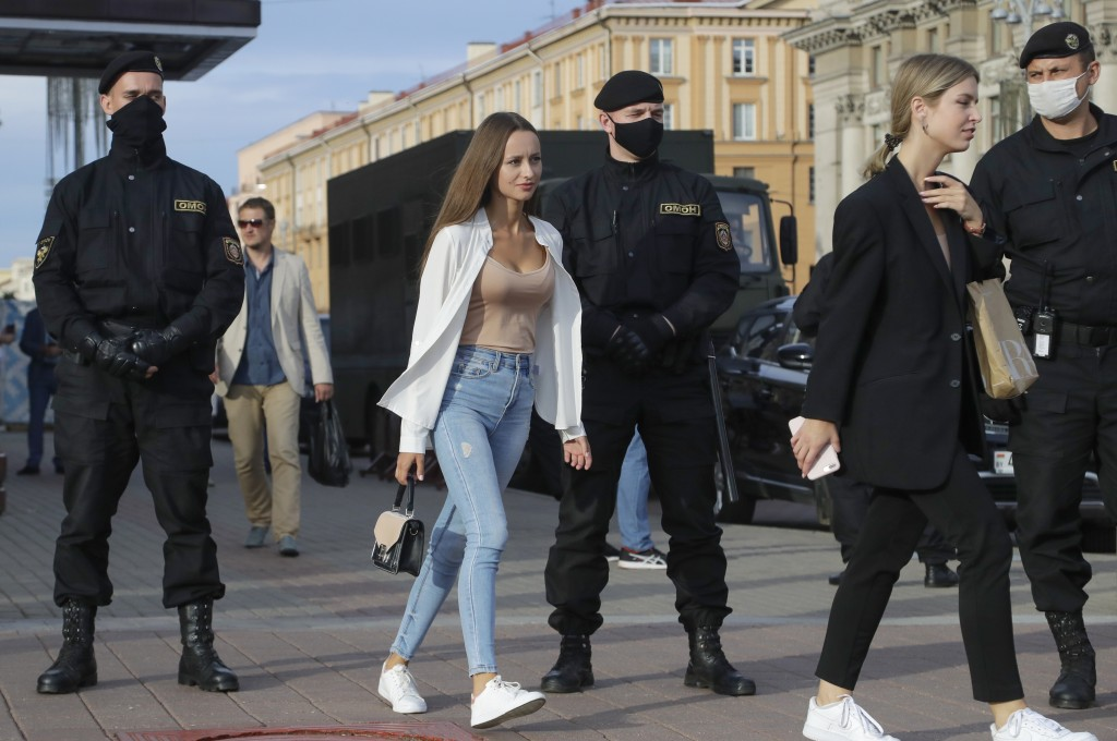 Belarusian police block the street in Minsk, Belarus, Wednesday, July 15, 2020. The country's central election commission on Tuesday allowed five cand...