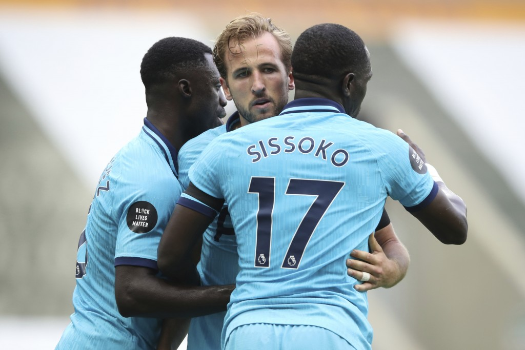 Tottenham's Harry Kane, center, celebrates after scoring his side's third goal during the English Premier League soccer match between Newcastle United...