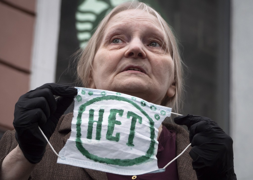 """Elena Osipova, 75, holds a face mask with sign """"No"""" during a rally to protest against the results of voting on amendments to the Constitution in St. P..."""