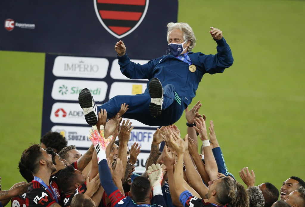 Flamengo's coach Jorge Jesus is thrown in the air by his players after winning the Rio de Janeiro state championship final soccer match at the Maracan...