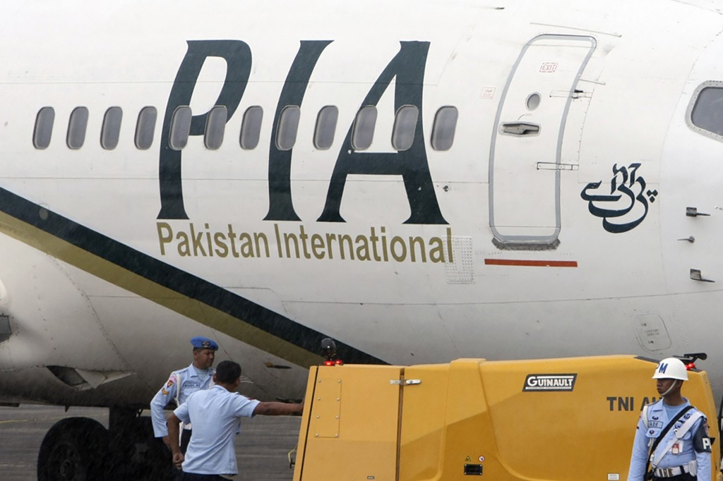 FILE - In this March 7, 2011, file photo, a Pakistan International Airlines passenger jet is parked on the tarmac at a military base in Makassar, Indo...