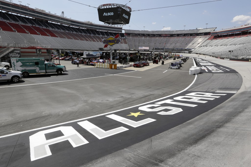 Work goes on in the infield behind an All-Star Race logo before the NASCAR All-Star auto race at Bristol Motor Speedway in Bristol, Tenn, Wednesday, J...