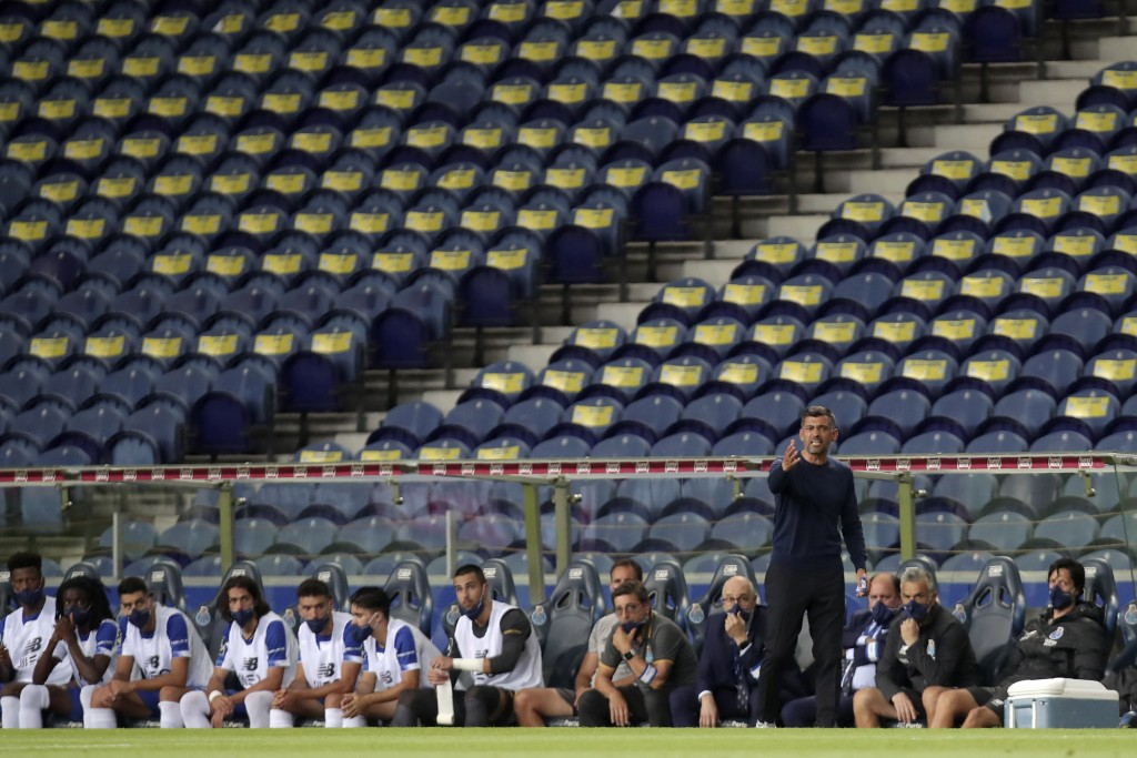 Porto head coach Sergio Conceicao, standing, gestures during the Portuguese League soccer match between FC Porto and Sporting CP at the Dragao stadium...