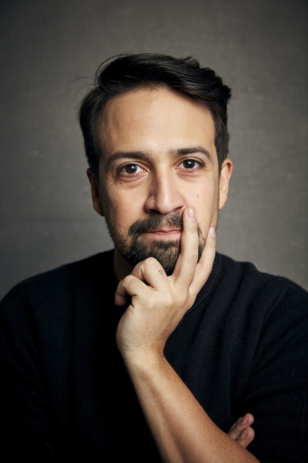 FILE - Lin-Manuel Miranda poses for a portrait during the Sundance Film Festival in Park City, Utah on Jan. 25, 2020.  The playwright, actor and songw...