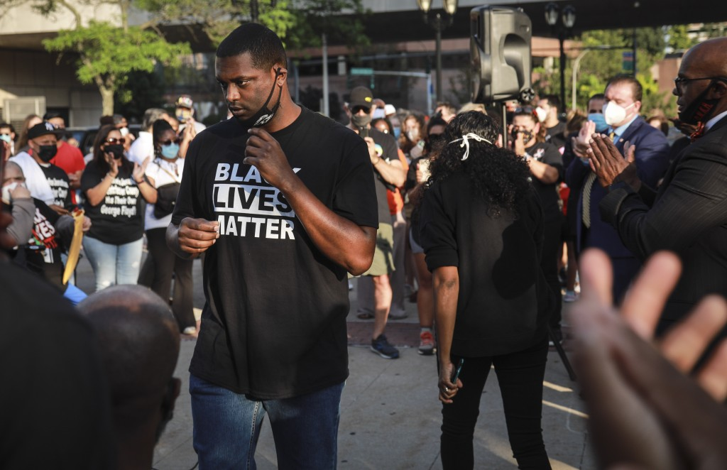 Mondaire Jones, winner of the Democratic primary for the 17th Congressional District, is applauded after addressing a Black Lives Matter rally, Wednes...