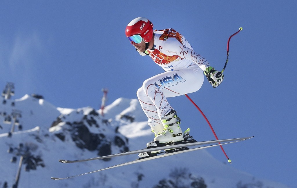 FILE - In this Feb. 13, 2014, file photo, United States' Bode Miller makes a jump during men's downhill combined training at the Sochi 2014 Winter Oly...