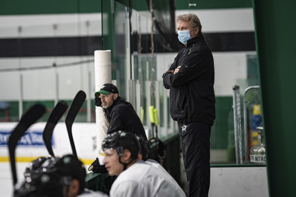 In this photo provided by the Dallas Stars NHL hockey team, interim head coach Rick Bowness watches practice at Comerica Center in Frisco, Texas, Tues...