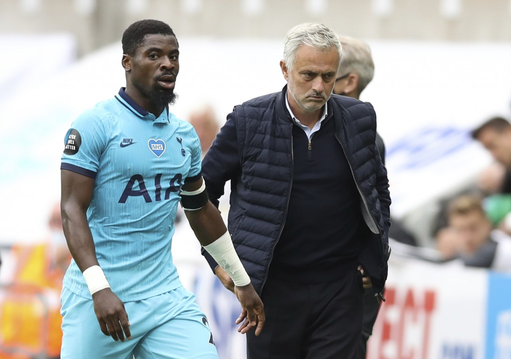 Tottenham's manager Jose Mourinho, right, and Tottenham's Serge Aurier during the English Premier League soccer match between Newcastle United and Tot...