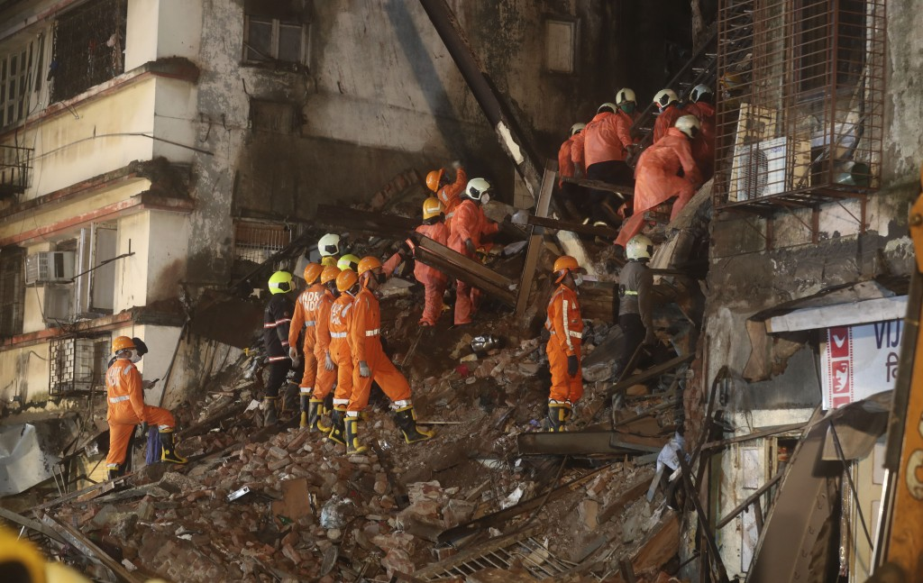 Rescuers work at the site after a six-storey residential building collapsed in Mumbai, India, Thursday, July 16, 2020. (AP Photo/Rafiq Maqbool)