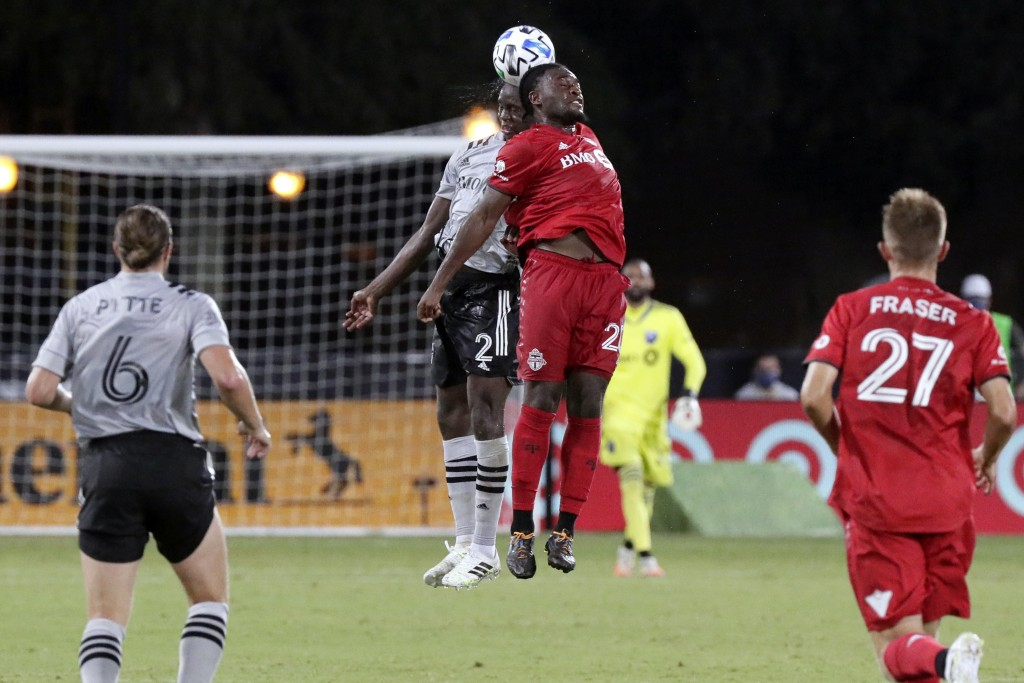 Toronto FC forward Ayo Akinola (20) and Montreal Impact midfielder Victor Wanyama (2) battle for a head ball during the second half of an MLS soccer m...