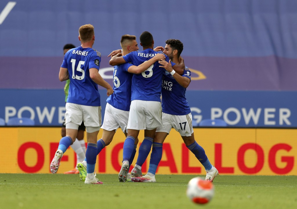 Leicester's Ayoze Perez, right, celebrates with teammates after scoring his side's opening goal during the English Premier League soccer match between...