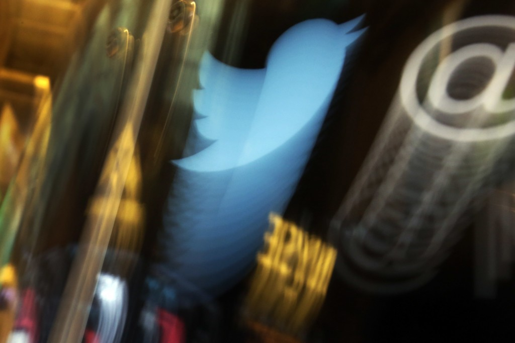 FILE - In this Wednesday Nov. 6, 2013, file photo, the Twitter logo appears on an updated phone post on the floor of the New York Stock Exchange. Hack...