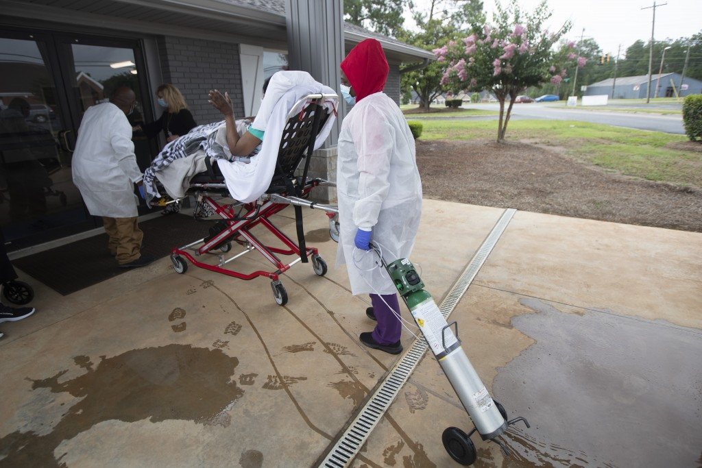 A resident on a stretcher is brought back to Southern Pines in Warner Robins, Ga., on Thursday, June 25, 2020. With a coronavirus lockdown in place, t...