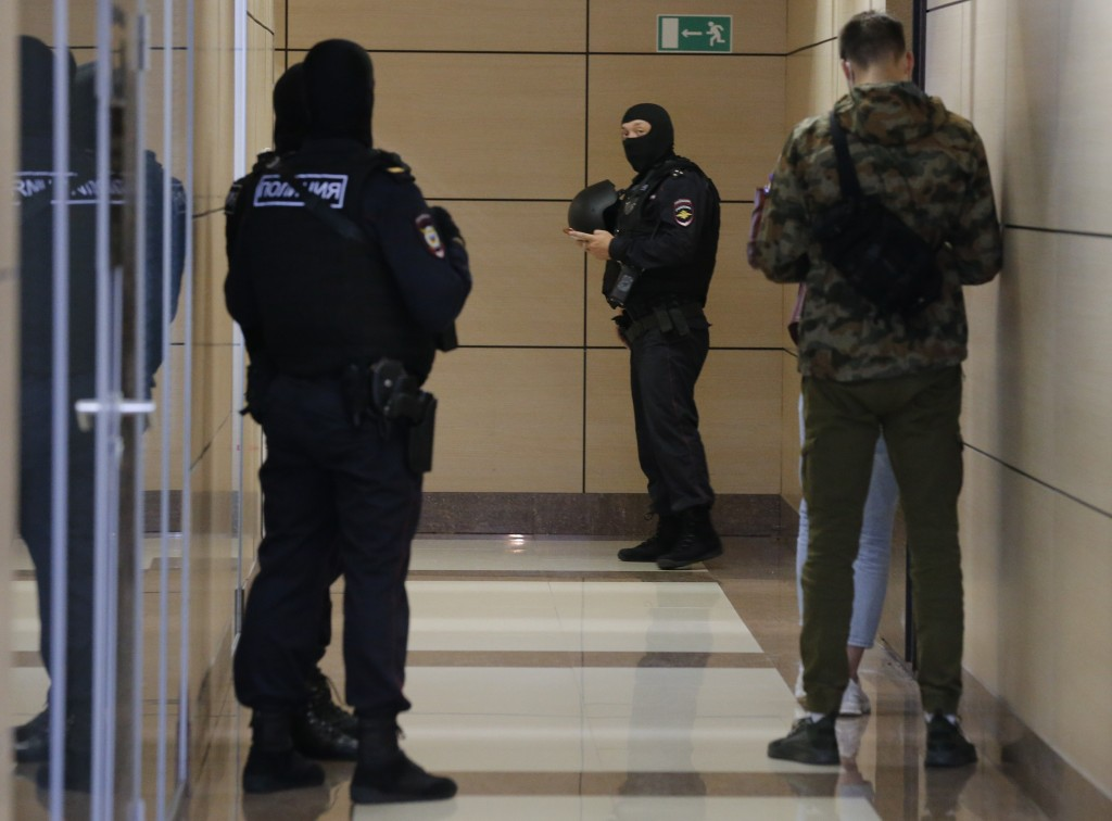 Police raid the offices of Alexei Navalny's Foundation for Fighting Corruption in Moscow, Russia, Friday, July 17, 2020. Opposition leader Navalny see...