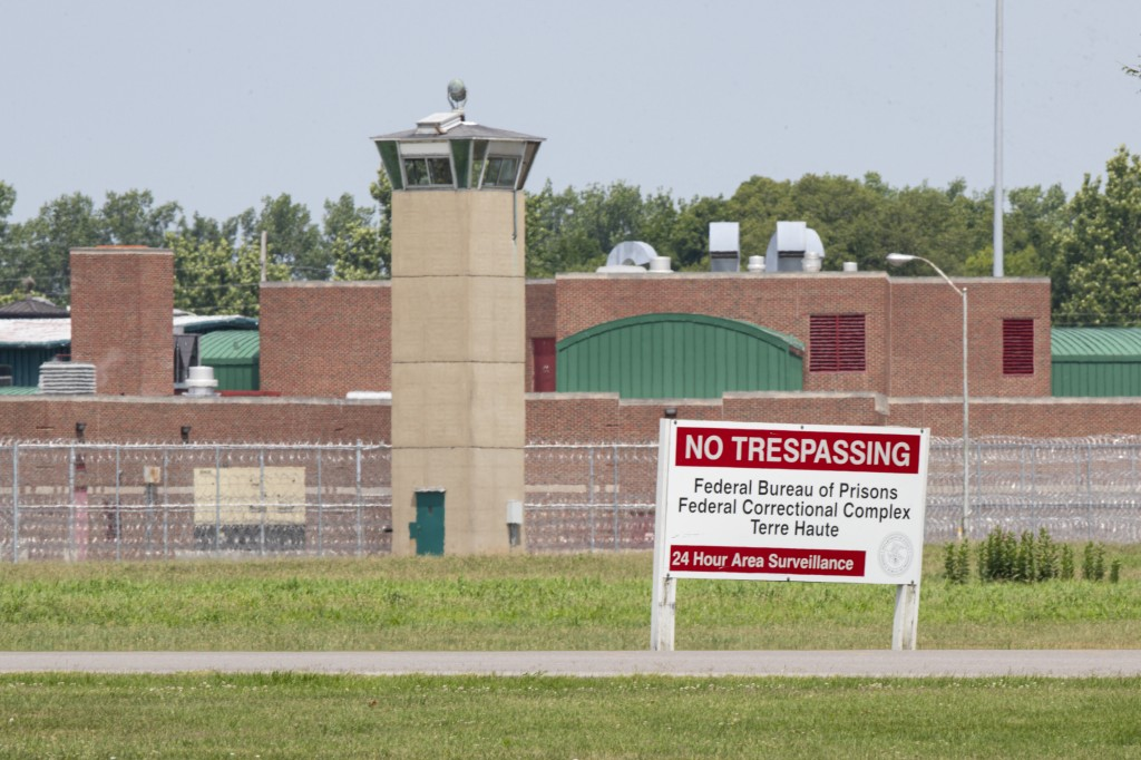 FILE - This July 15, 2020, file photo shows the entrance to the federal prison in Terre Haute, Ind. A meth kingpin from Iowa who killed five people, i...