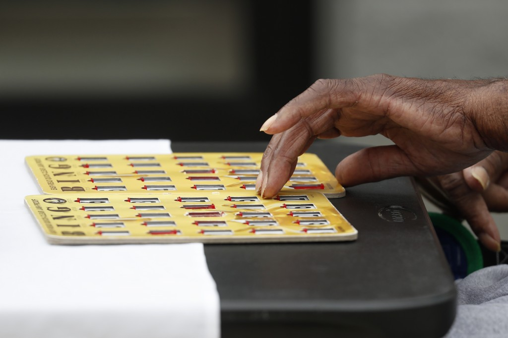 A resident at the Southern Pines nursing home takes part in the daily bingo game in Warner Robins, Ga., on Thursday, June 25, 2020. (AP Photo/John Baz...