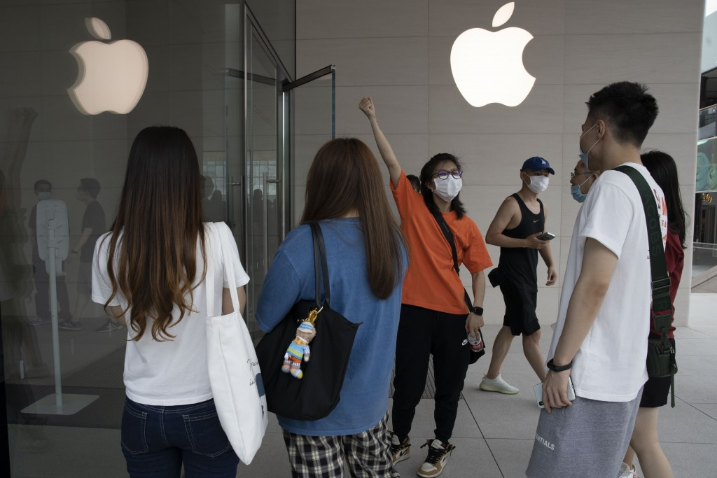 Visitors gather near a newly opened store opened at Sanlitun in Beijing, China on Friday, July 17, 2020. China's economy rebounded from a painful cont...