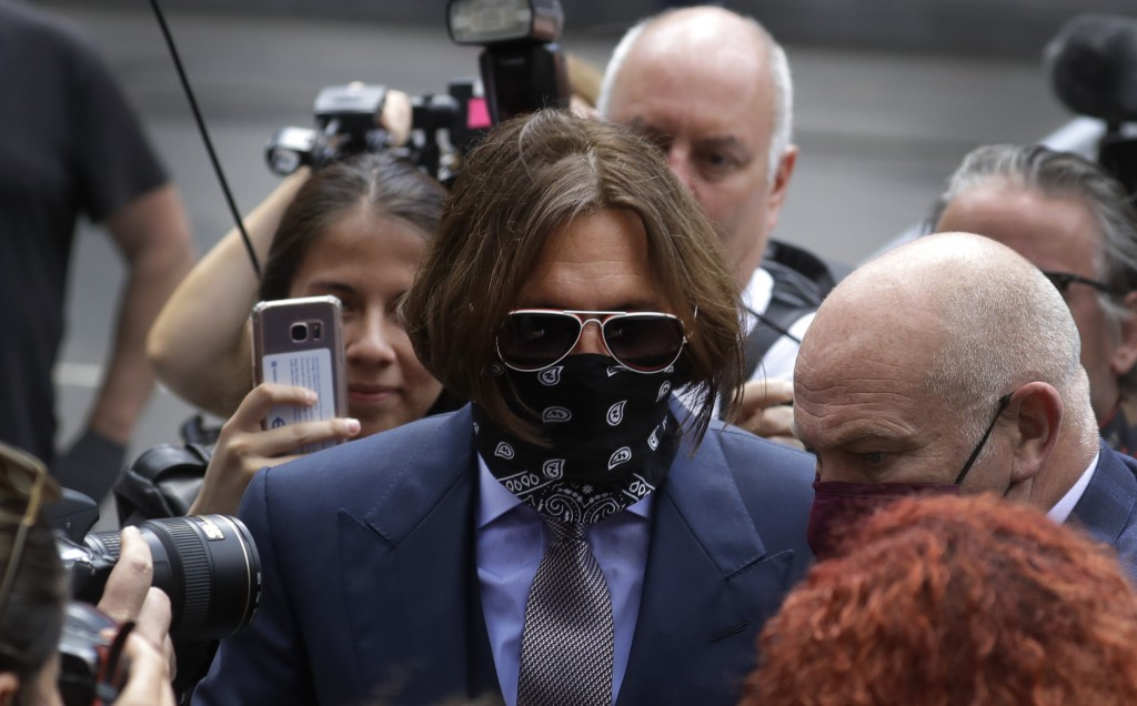 Actor Johnny Depp is surrounded by fans as he arrives at the High Court in London, Friday, July 17, 2020. Depp is suing News Group Newspapers, publish...