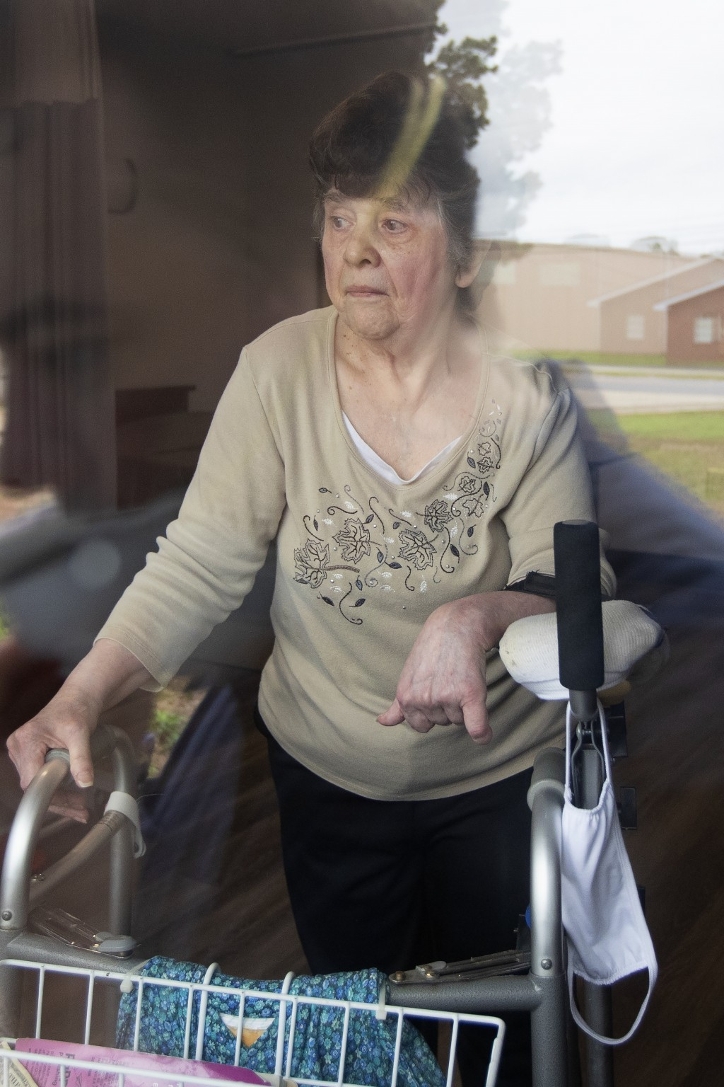 Southern Pines nursing home resident Judy Morey is seen through the window of her room during an interview in Warner Robins, Ga., on Thursday, June 25...