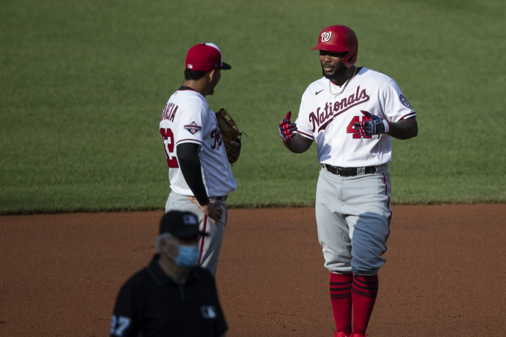 Washington Nationals shortstop Luis Garcia, left, talks with Howie Kendrick as he stands on second base during a baseball intrasquad game at Nationals...