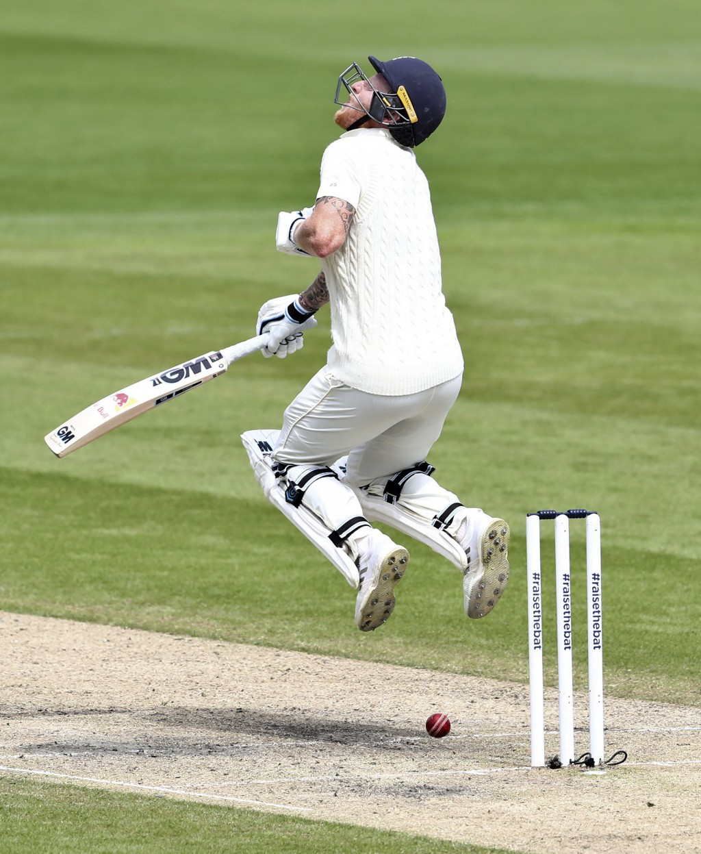 England's Ben Stokes is struck by the ball on a delivery by West Indies' Shannon Gabriel during the second day of the second cricket Test match betwee...