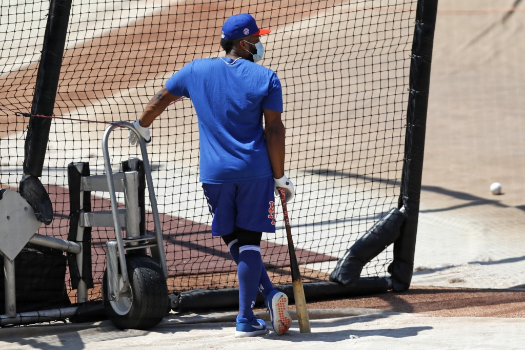 New York Mets' Robinson Cano leans on his bat as he waits his turn in the cage during baseball practice at Citi Field, Thursday, July 16, 2020, in New...