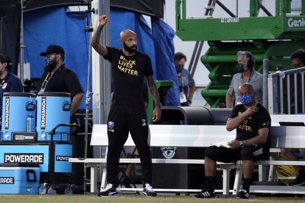 Montreal Impact coach Thierry Henry, left, gestures on the sideline during the first half of an MLS soccer match against Toronto FC, Thursday, July 16...