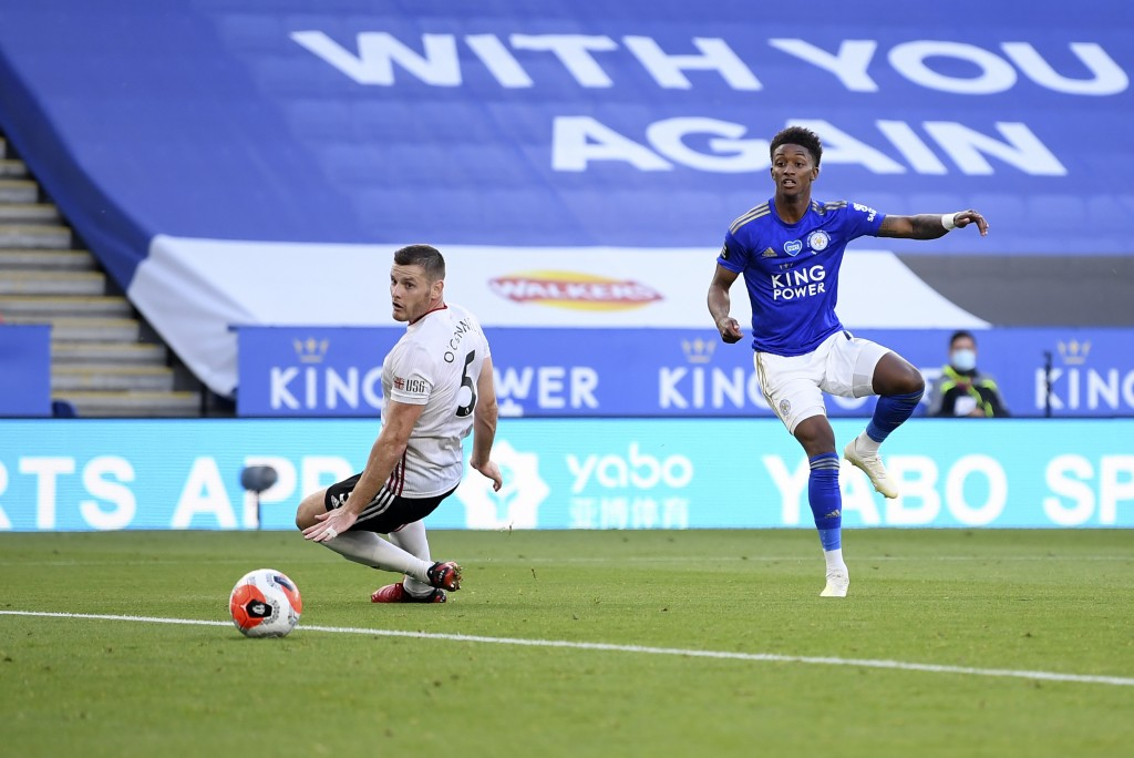 Leicester's Demarai Gray, right, scores his side's second goal during the English Premier League soccer match between Leicester City and Sheffield Uni...
