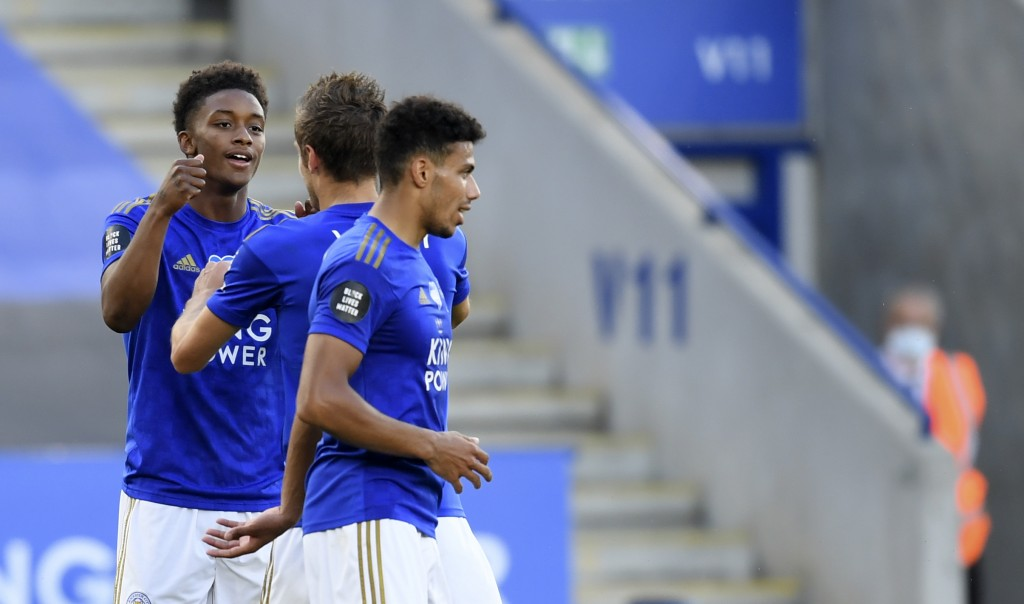 Leicester's Demarai Gray, left, celebrates with teammates after scoring his side's second goal during the English Premier League soccer match between ...