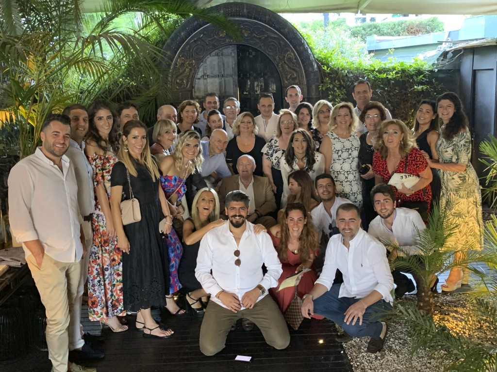 In this family photo provided by Dr. Caner Dilmener, Dr. Murat Dilmener, seated center, a professor of infectious diseases in Istanbul is pictured in ...