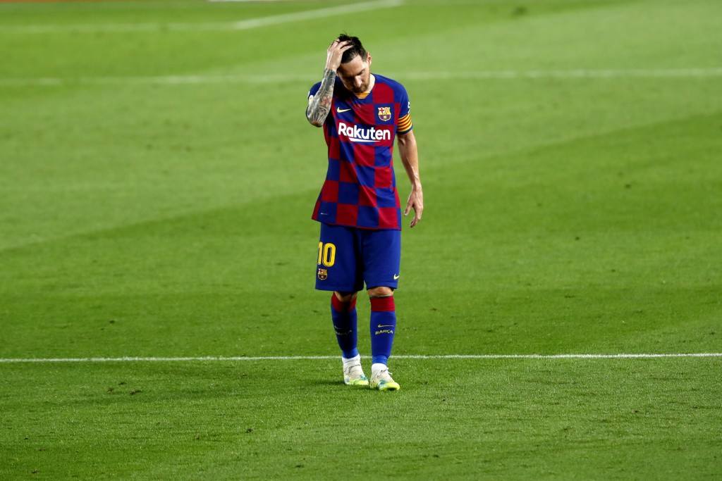Barcelona's Lionel Messi reacts after the end of a Spanish La Liga soccer match between Barcelona and Osasuna at the Camp Nou stadium in Barcelona, Sp...