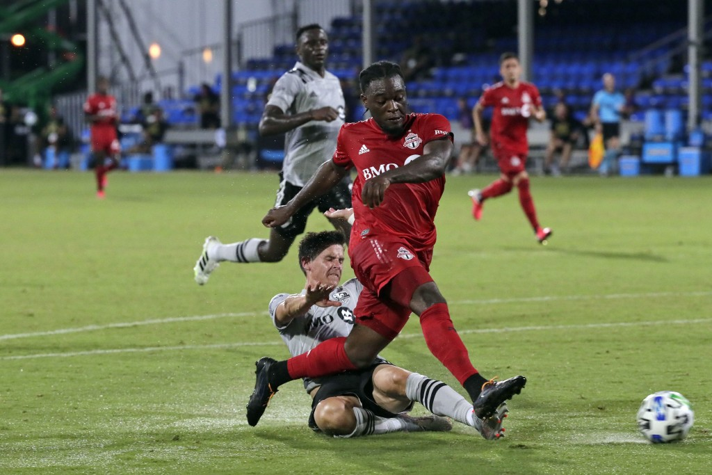 Toronto FC forward Ayo Akinola, front, scores his second goal of the game during the first half of an MLS soccer match against the Montreal Impact, Th...
