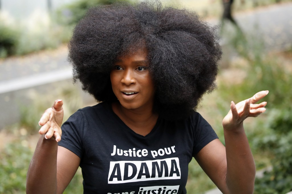 """Assa Traore, wearing a shirt that reads: """"Justice for Adama, without Justice you will never be in Peace,"""" attends an interview in Ivry-sur-Seine, on t..."""