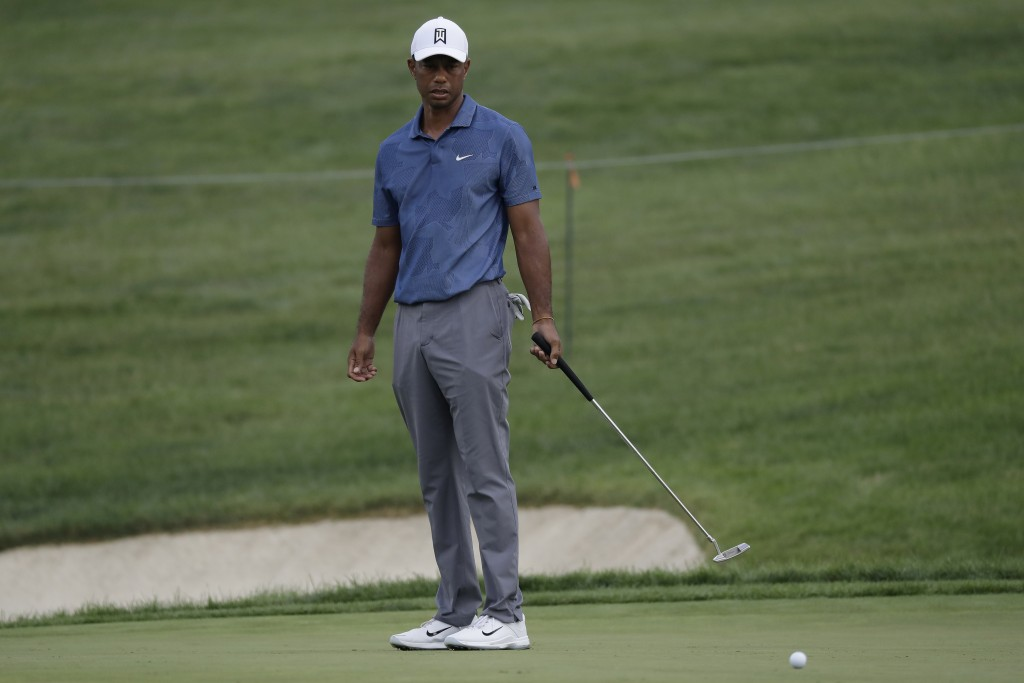 Tiger Woods reacts after missing a birdie putt on the 14th green during the second round of the Memorial golf tournament, Friday, July 17, 2020, in Du...
