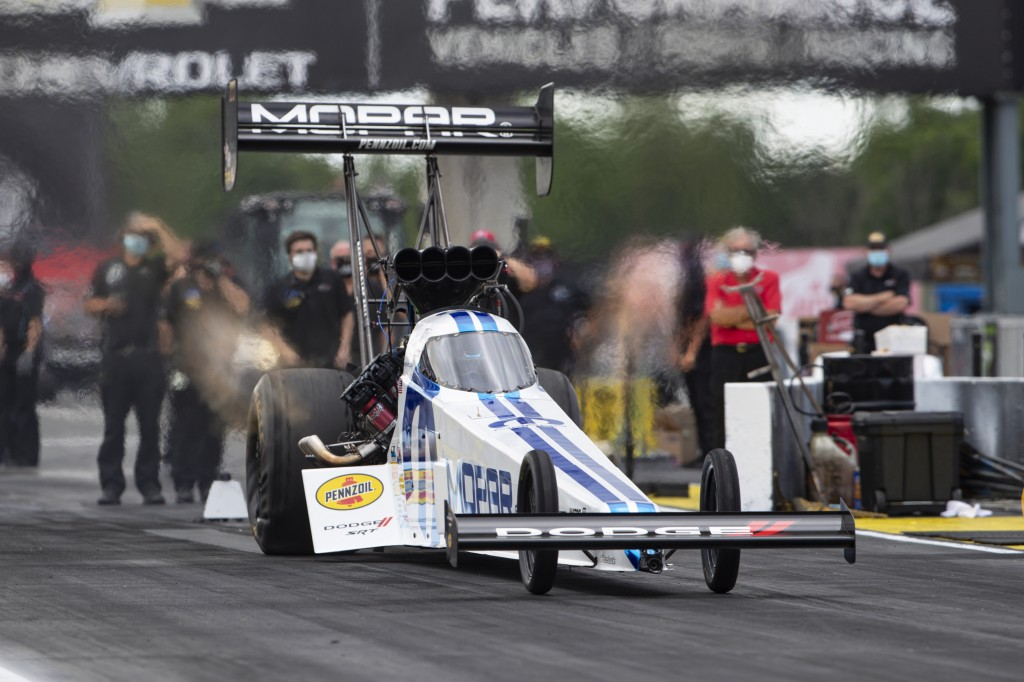 Leah Pritchett, in a Top Fuel dragster, launches from the starting line on a practice run for an NHRA drag racing event in Brownsburg, Ind., Friday, J...