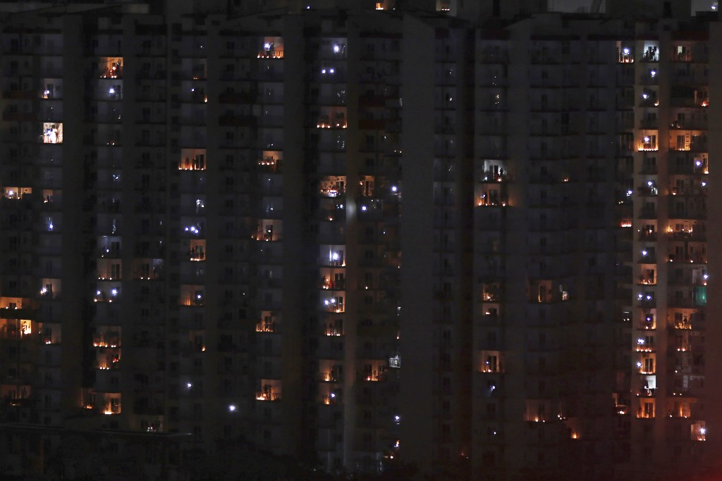 Balconies are illuminated with candles and torches to mark the country's fight against COVID-19 in Greater Noida, a suburb of New Delhi, India, April ...