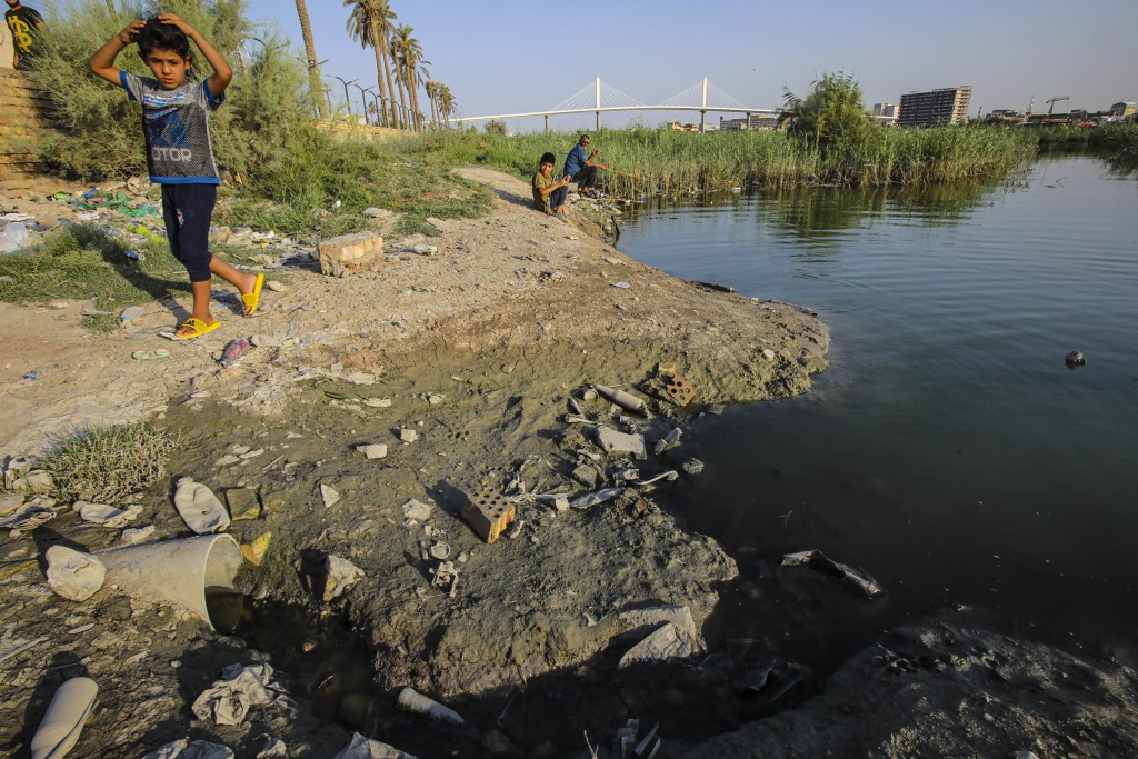 A child walks on the bank of the Shatt al-Arab waterway in Basra, Iraq on July 13, 2020. Iraq's minister of water resources said Thursday, July 16, 20...