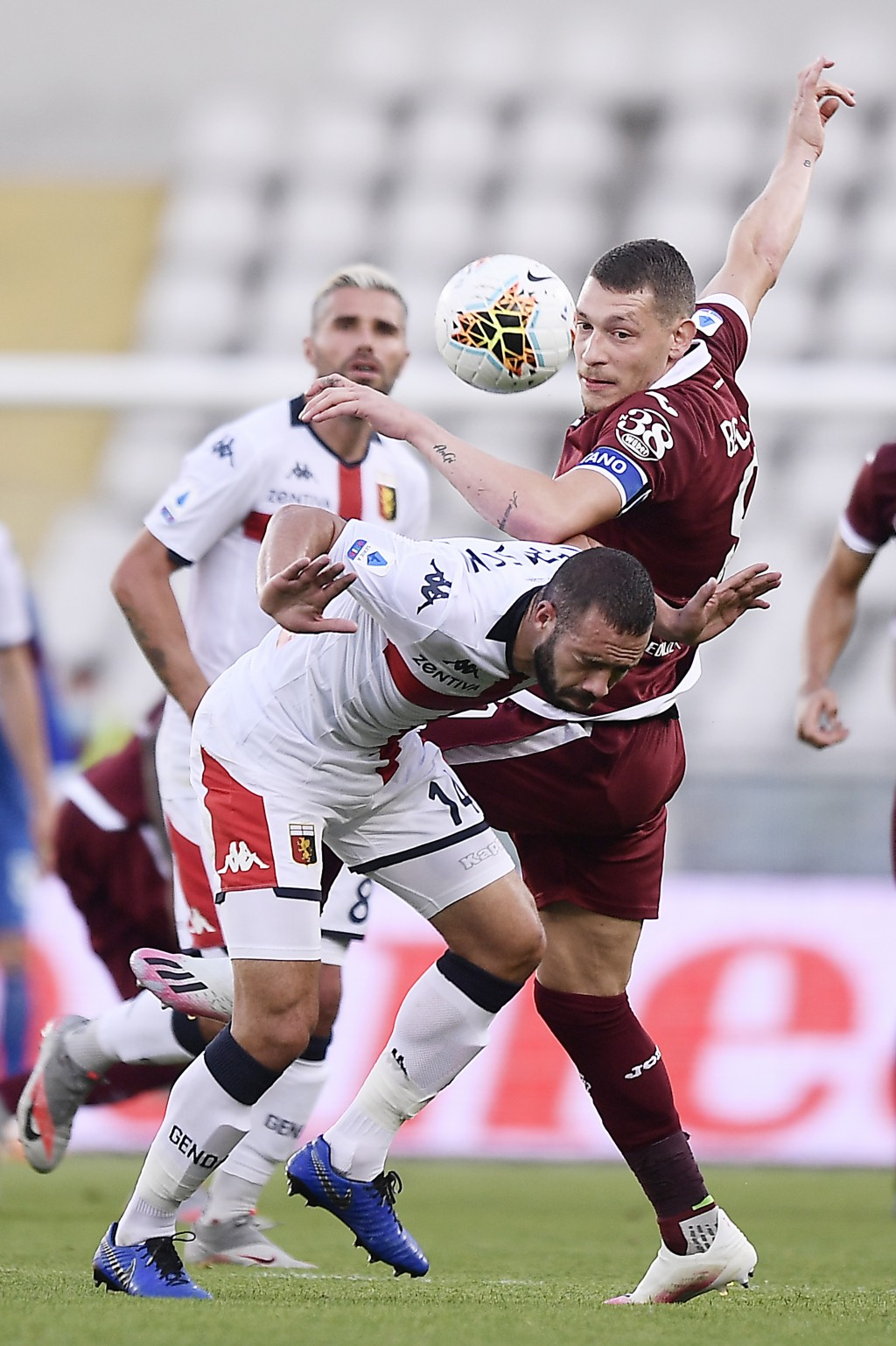 Torino's Andrea Belotti and Genoa's Davide Biraschi, left, vie for the ball during the Serie A soccer match between Torino and Genoa, at the Olympic S...