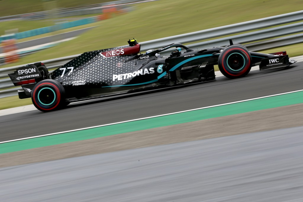 Mercedes driver Valtteri Bottas of Finland steers his car during the first practice session for the Hungarian Formula One Grand Prix at the Hungarorin...