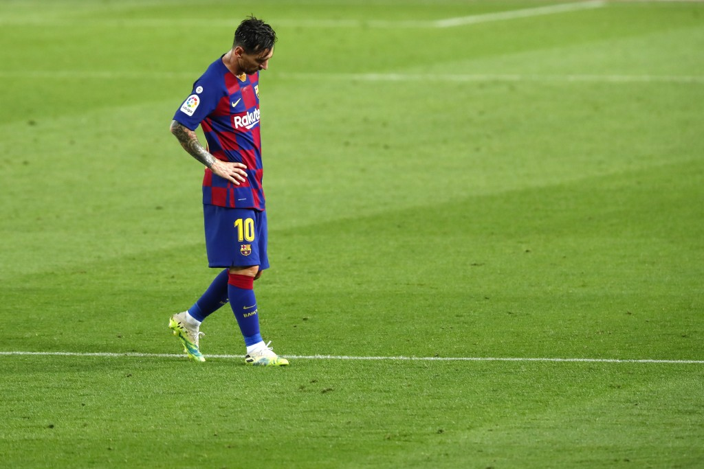 Barcelona's Lionel Messi dejected as walks after the end of a Spanish La Liga soccer match between Barcelona and Osasuna at the Camp Nou stadium in Ba...