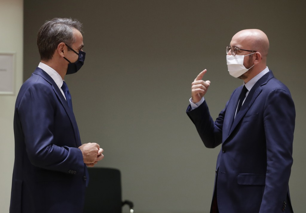 European Council President Charles Michel, right, speaks with Greek Prime Minister Kyriakos Mitsotakis during a round table meeting at an EU summit in...