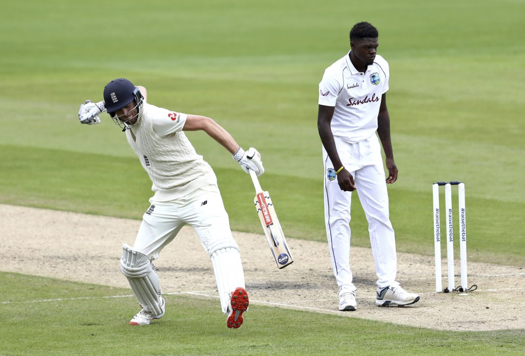 England's Dom Sibley, left, celebrates scoring a century during the second day of the second cricket Test match between England and West Indies at Old...