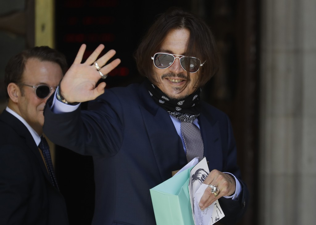 Actor Johnny Depp arrives at the High Court in London, Friday, July 17, 2020. Depp is suing News Group Newspapers, publisher of The Sun, and the paper...