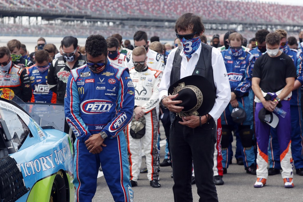 FILE - In this June 22, 2020, file photo, team owner Richard Petty, right, stands next to driver Bubba Wallace during the national anthem prior to the...