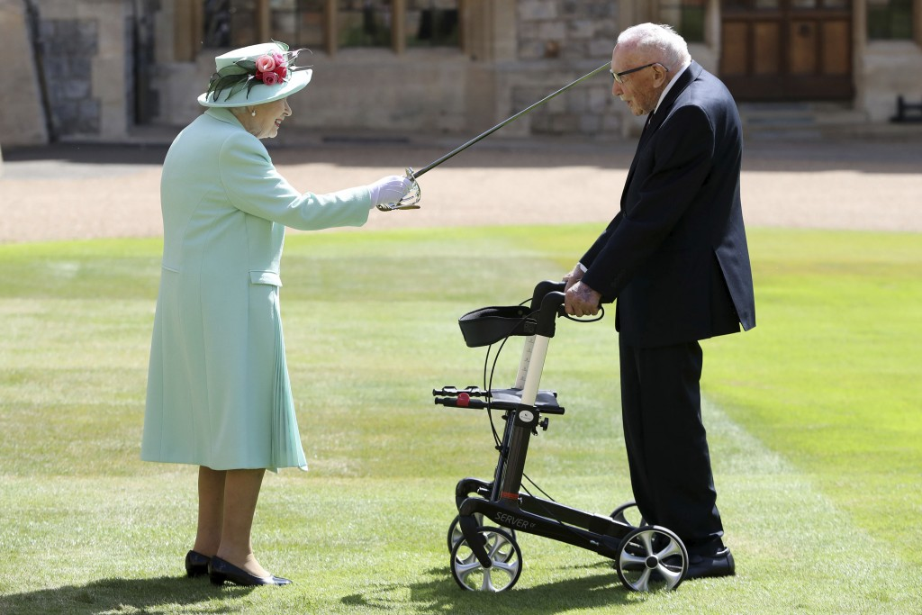 Captain Sir Thomas Moore arrives to receive his knighthood from Britain's Queen Elizabeth, during a ceremony at Windsor Castle in Windsor, England, Fr...