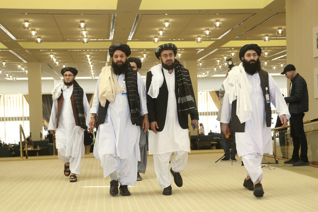 FILE- In this Feb. 29, 2020, file, photo, Afghanistan's Taliban delegation arrive for the agreement signing between Taliban and U.S. officials in Doha...