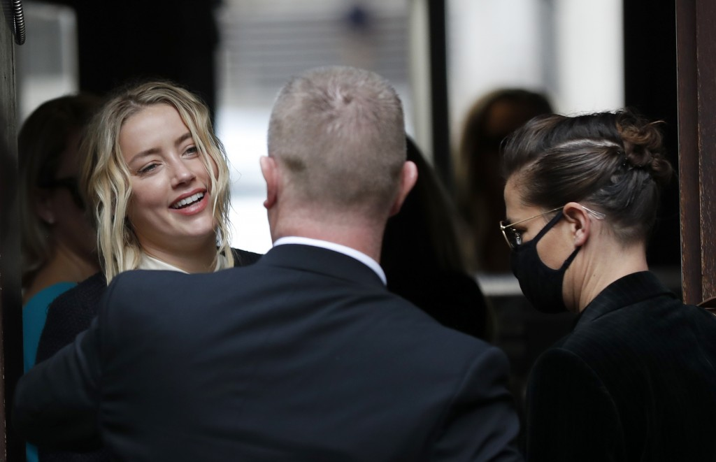 Amber Heard, actress and former wife of Johnny Depp, left, arrives at the High Court in Londonin London, Friday, July 17, 2020. Actor Johnny Depp is s...