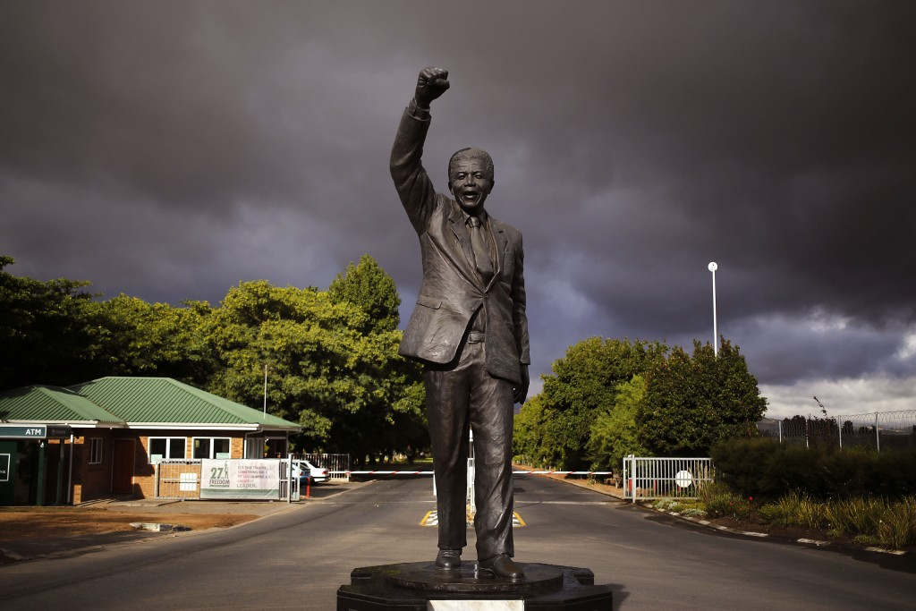 FILE - In this Feb. 10, 2015, file photo a statue of former South African President Nelson Mandela, marks the spot outside the Victor Verster prison, ...