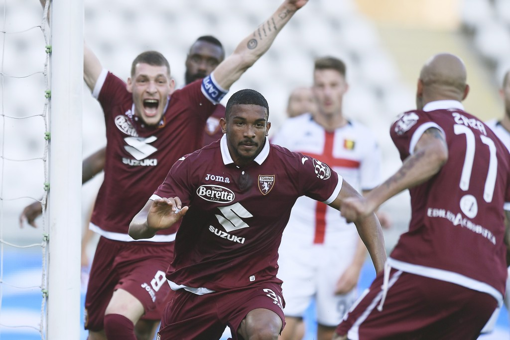 Torino's Gleison Bremer, center, celebrates with his teammates Simone Zaza, right, and Andrea Belotti after scoring his side's opening goal during the...