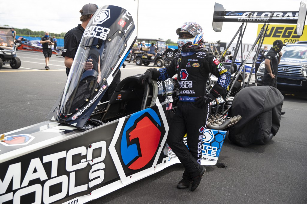 Antron Brown waits to climbs into his car for a run in Top Fuel during practice for an NHRA drag racing event in Brownsburg, Ind., Friday, July 10, 20...